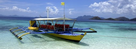 Image - a brightly painted outrigger boat, Palawan island, the Philippines.