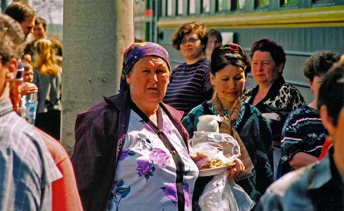 Image - The Trans-Siberian - Old woman on platform selling blini