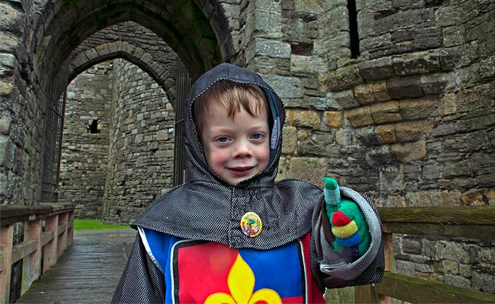 Image: Boy dressed as a knight at a castle