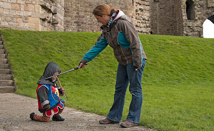 Image: A boy in knight's costume at a castle in Wales